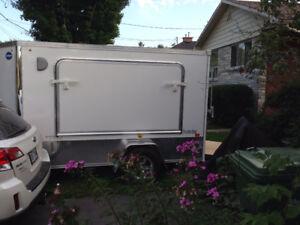 Small camper/toy hauler trailer.