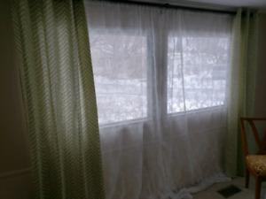 Green and white lace curtains
