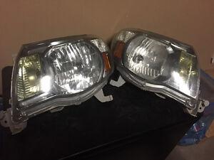 Left and right 09 tacoma headlights