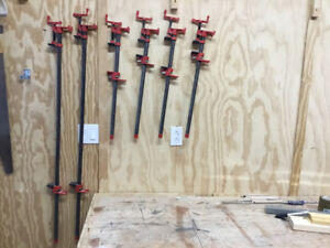 "Three 24"" and three 48"" metal clamps"