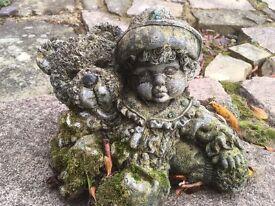 Child and teddy garden ornament
