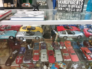 Nostalgia car collectibles, rugs, repurposed plus 1000 booths