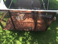 Utility trailer with drop down gate
