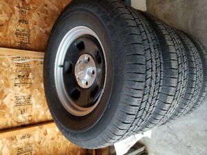 4 good year tires and dodge Rims For Sale.