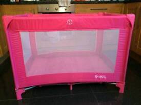 Pink redkite travel cot