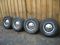 """15"""" Steel Rims Tires Hubcaps and Trim Rings Chevy 6 bolt GM"""