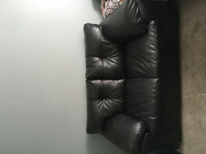 Black leather love seat for sale !