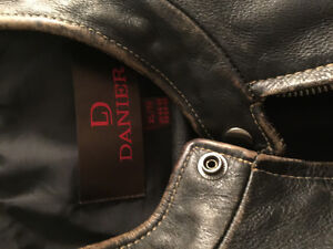 Danier leather jacket for sale. Has that weathered look.