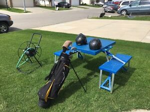 Take all for $60 - golf, helmets, table