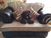 Chesterfield settee & love seat. Brand new. Was 2000