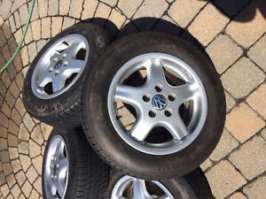 German VW 15 mags with 1 y. used all season tires 195/65/15