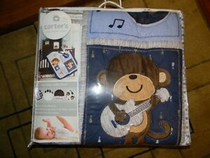 Brand New Carter's 4 piece crib beding set ( Monkey collection)