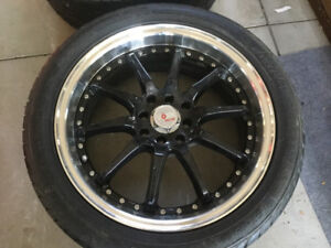 Four Voxx Racing rims with Akina 215/45 ZR17 91W tires