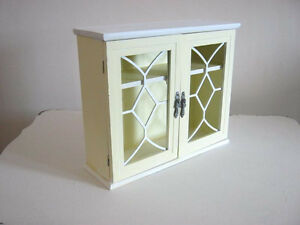 Small cupboard with wrought iron grate