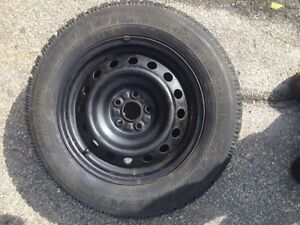 Set of four 15 inch rims and tires