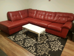 Used sectional with area rug and free table