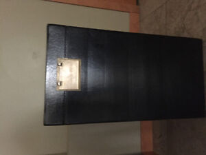 Black decor box with brass handles and latch.
