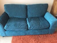Two seater teal sofa one year old