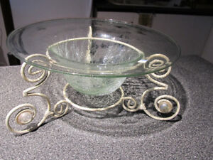 Decorative cracked glass bowl set in metal base.