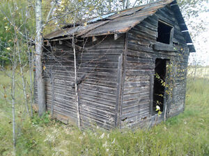 old grainery,barn,  farm building, corral boards