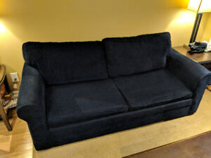 Navy blue couch with fold-out bed