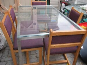 Glasstop table with five chairs