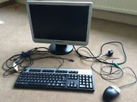 HP keyboard and mouse and Samsung monitor
