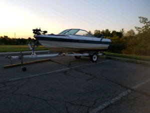 **READY TO GO!** 15' bow rider/fishing boat with trailer!