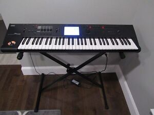 Korg M50 with stand