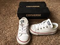 Infant Converse Trainers.