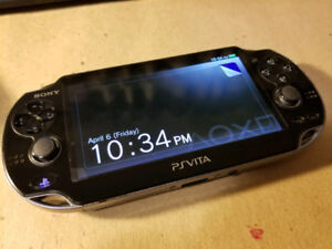 PS Vita system and 3 Games