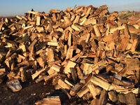 seasoned firewood $100 per face cord delivered and stacked