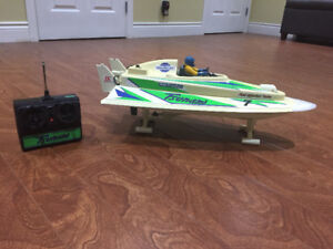 RC toys: two trucks and a boat