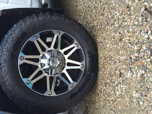 4 Toyo Open Country Tires and Riot Rims