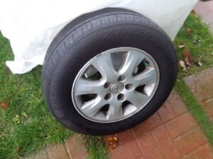 "4 - 15"" alloy rims with all season tires"