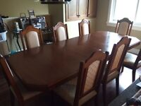 Dining room table with 8 chairs and buffet and hutch