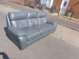 Fully reclining grey leather sofa