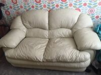 White leather 2 seater sofa. Good condition very heavy good quality sofa. Space needed.