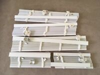 White and ivory Venetian blinds with tabs