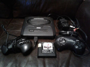 Selling Sega Genesis Console w/ two controllers, hockey game