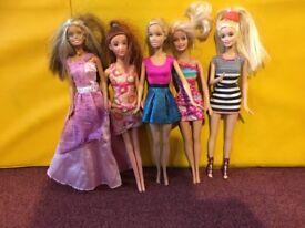Five (5) Barbie Dolls