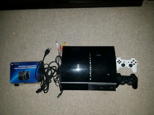 PS3 WITH 9 GAMES & 2 CONTROLLERS $150