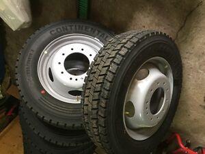 brand new  rimed tires 225\   reg pr. 700 asking 300