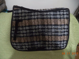 Checked brown, black and white saddle pad