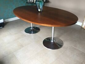 Oval shaped dining room table
