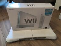 Nintendo Wii and Wii Fit board and game