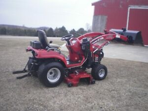 Case compact tractor with loader & mower