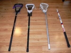Lacrosse shafts with heads