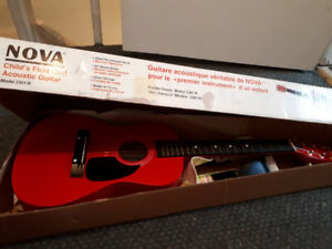 Child brand new guitar with tuner