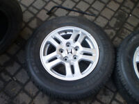 2 Honda  alloy Rims with Bridgestone Dueler H/T for sale